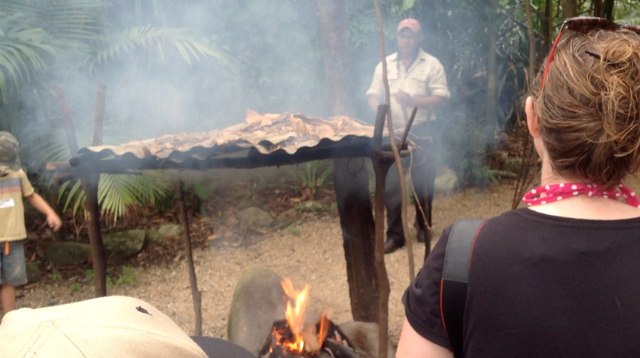 Small fire burning under a hut on ranger-guided tour in Daintree