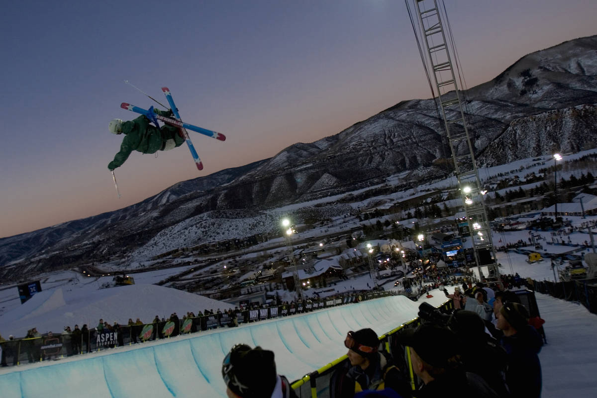 Extreme skier performing trick in a half pipe