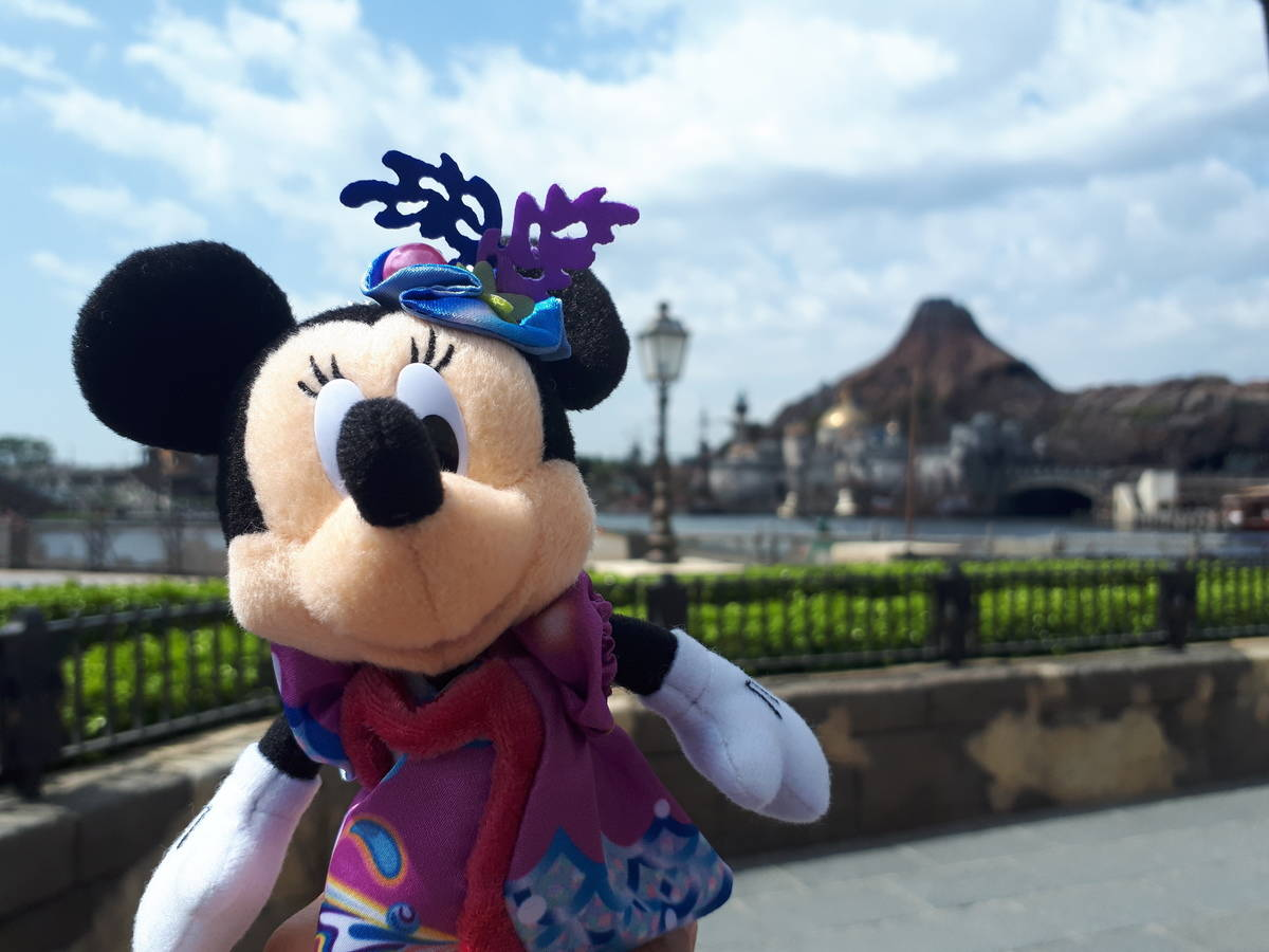 Minnie Mouse toy in front of volcano structure at Tokyo Disney Sea