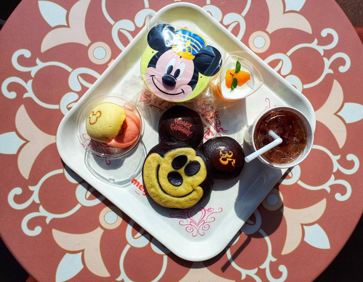 A tray of Disney-themed breads and cakes at Tokyo Disneyland