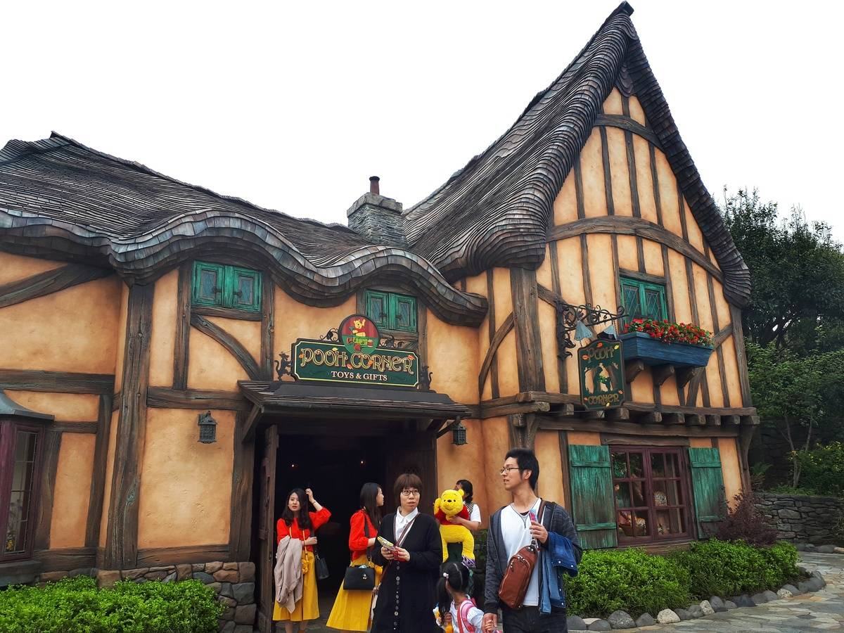 Cute yellow house of Pooh's Corner attraction at Tokyo Disneyland