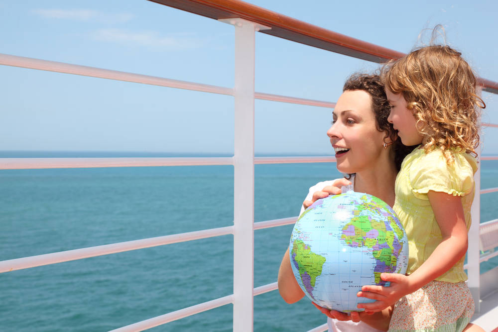 Mother and young child on balcony of cruise ship