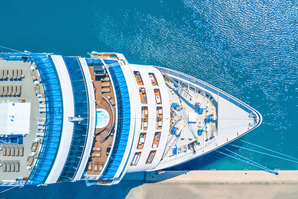 Aerial view of cruise ship through turquoise waters