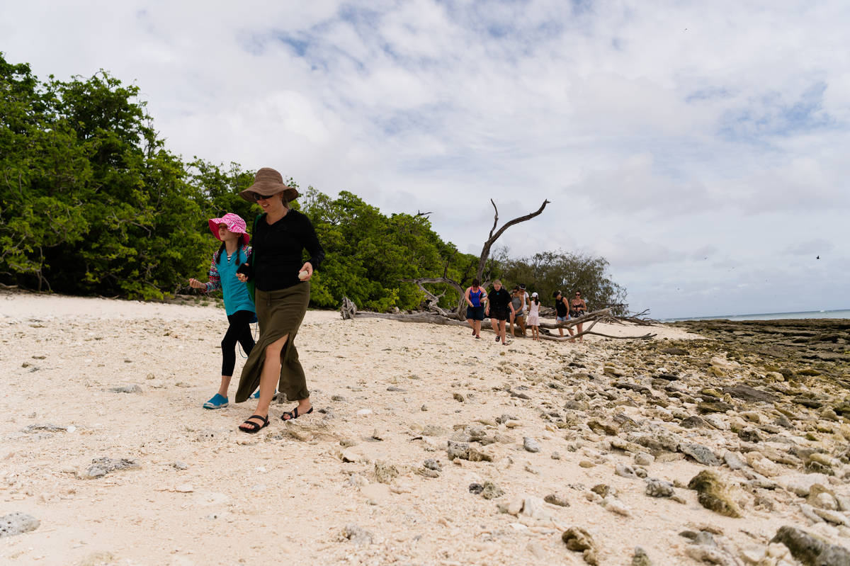 Mother and daughter explore the beach on Lady Musgrave Island