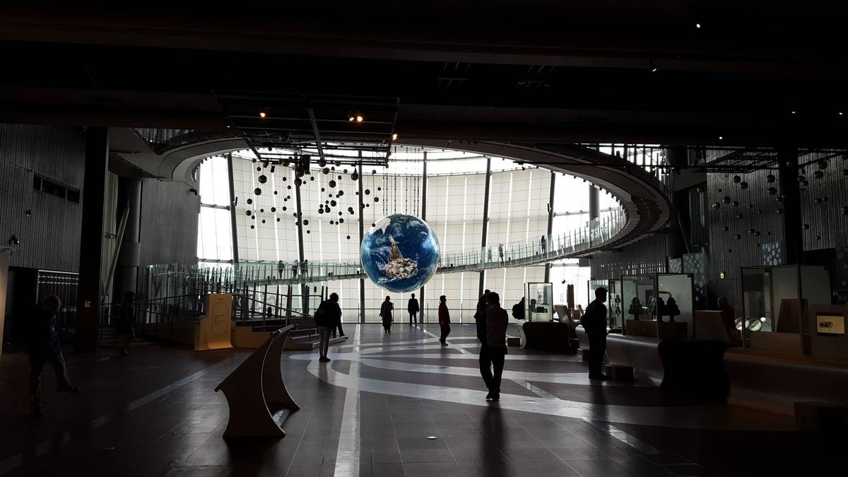 A huge globe suspended in the staircase of a Tokyo science musem