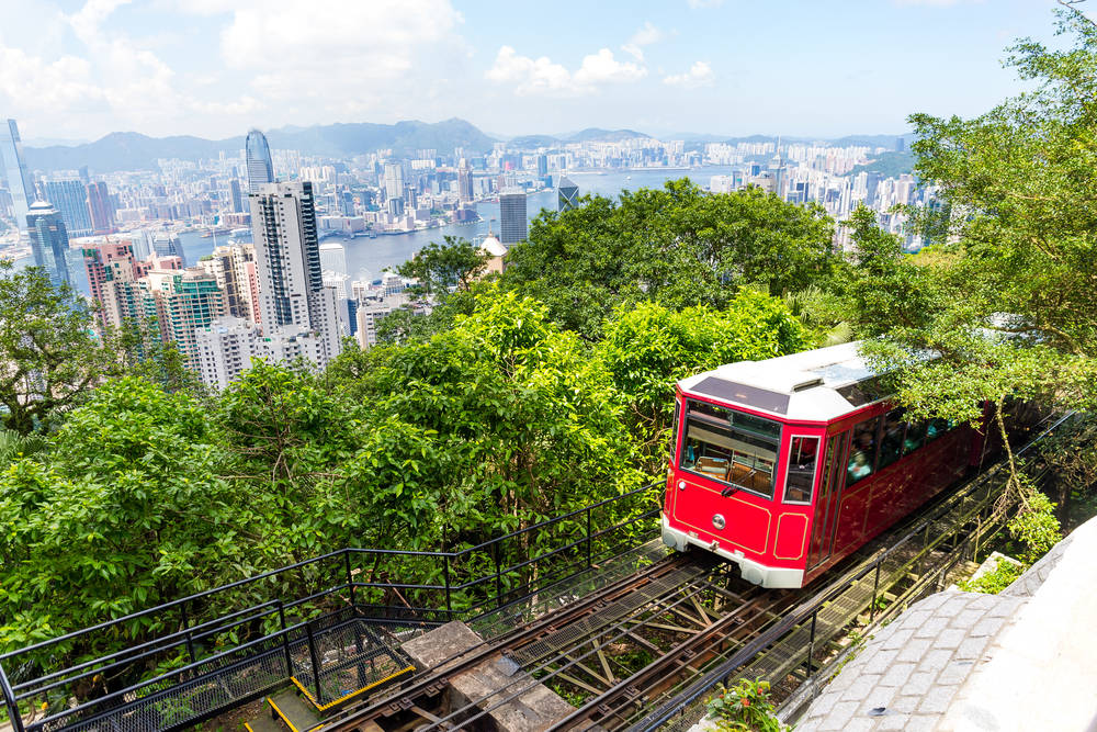 The Peak Tram emerging from a surprising amount of greenery in Hong Kong.