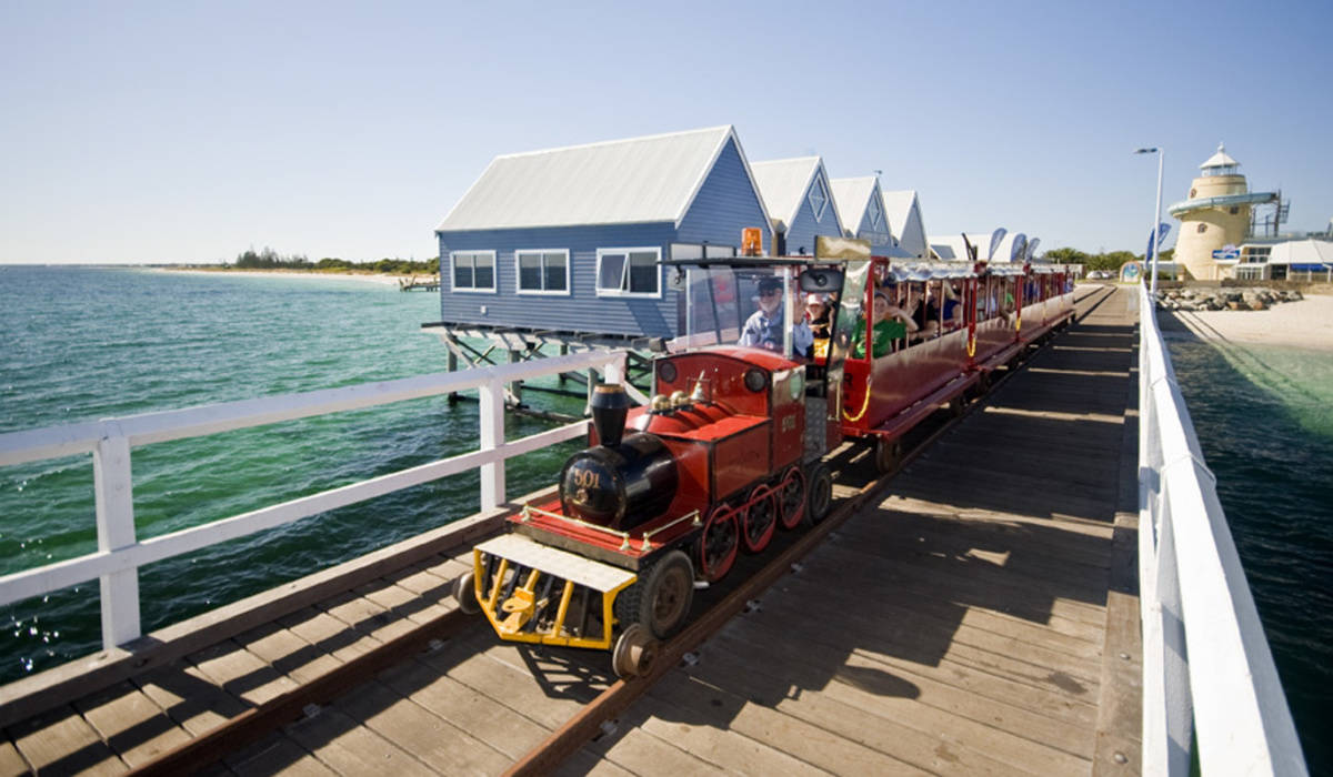 Busselton Jetty Tram driving past with passengers