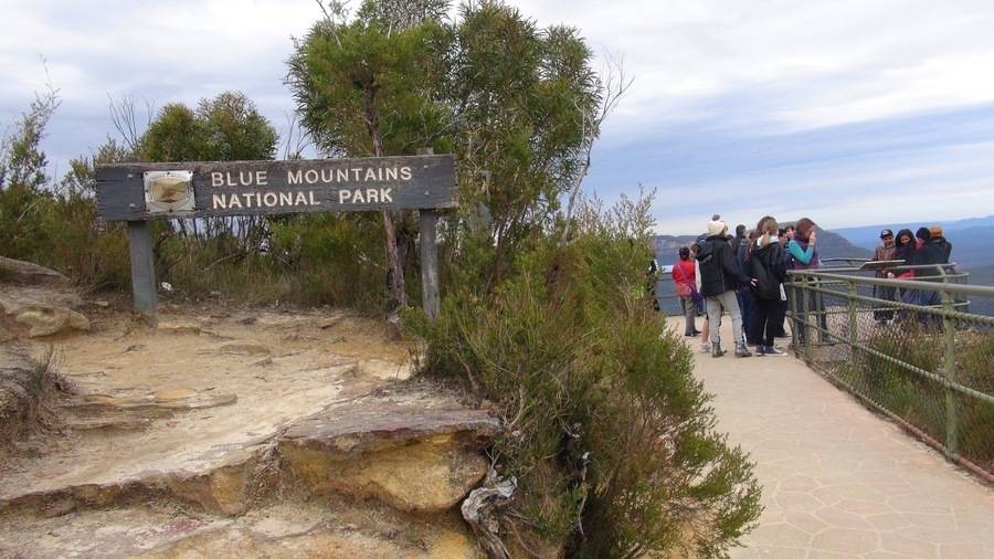 Sign at Blue Mountains lookout, people in background
