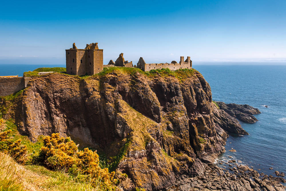 castle ruins on a cliff top in Scotland