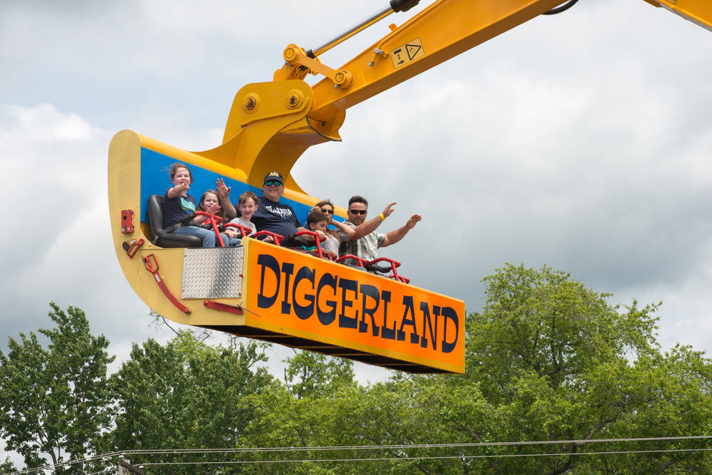 Theme-park enthusiasts ride a giant digger at Diggerland